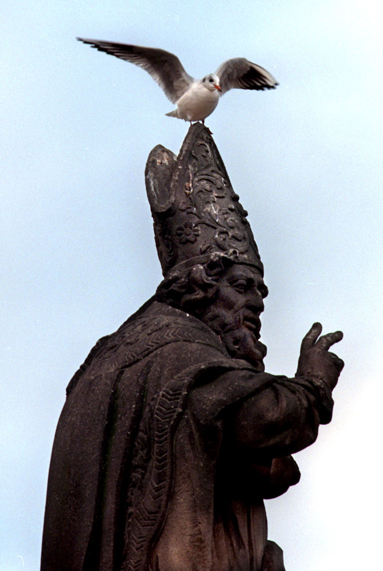 Prague-Statue-with-bird-on-head